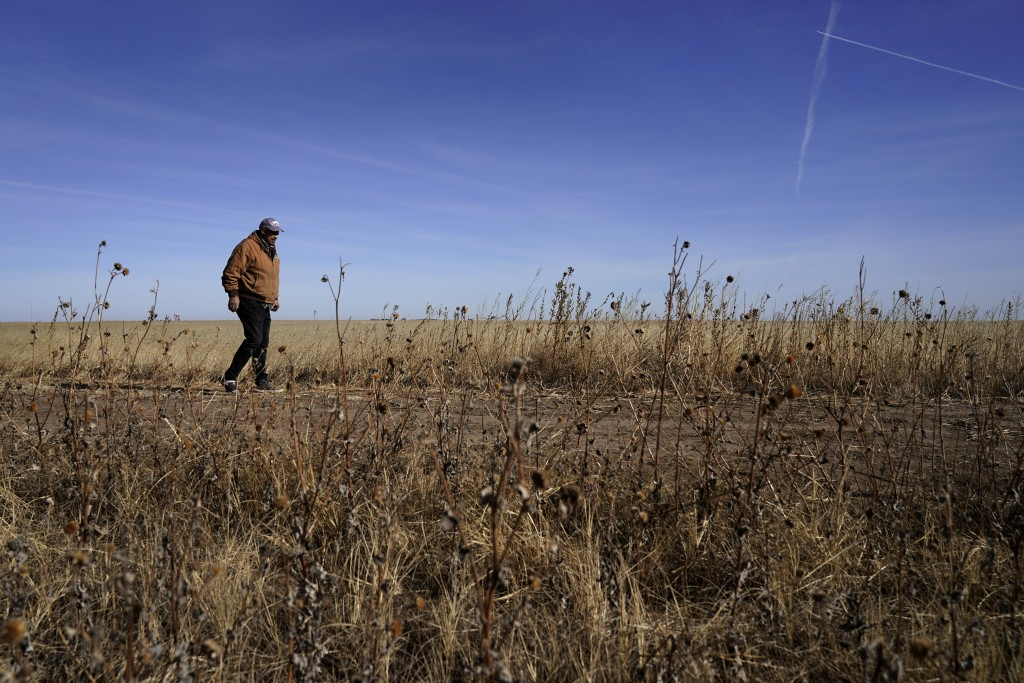 Rod Bradshaw walks through a field on his farm near Jetmore, Kan., Wednesday, Jan. 13, 2021. Bradshaw, who claims to be the last Black farmer in Hodge...