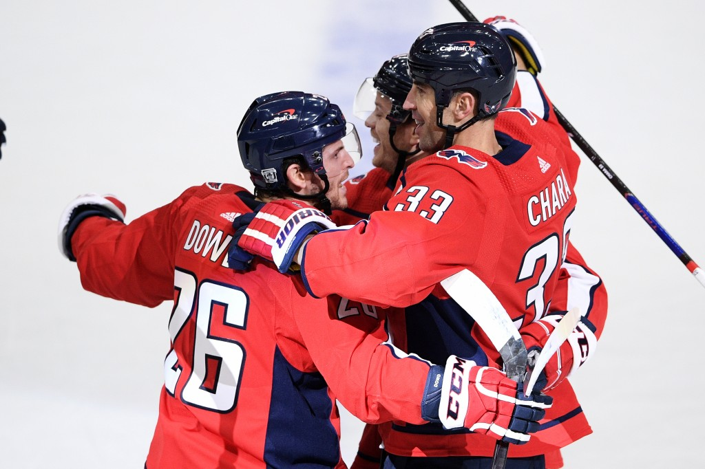 Washington Capitals defenseman Zdeno Chara (33) celebrates his goal with center Nic Dowd (26) during the first period of an NHL hockey game against th...