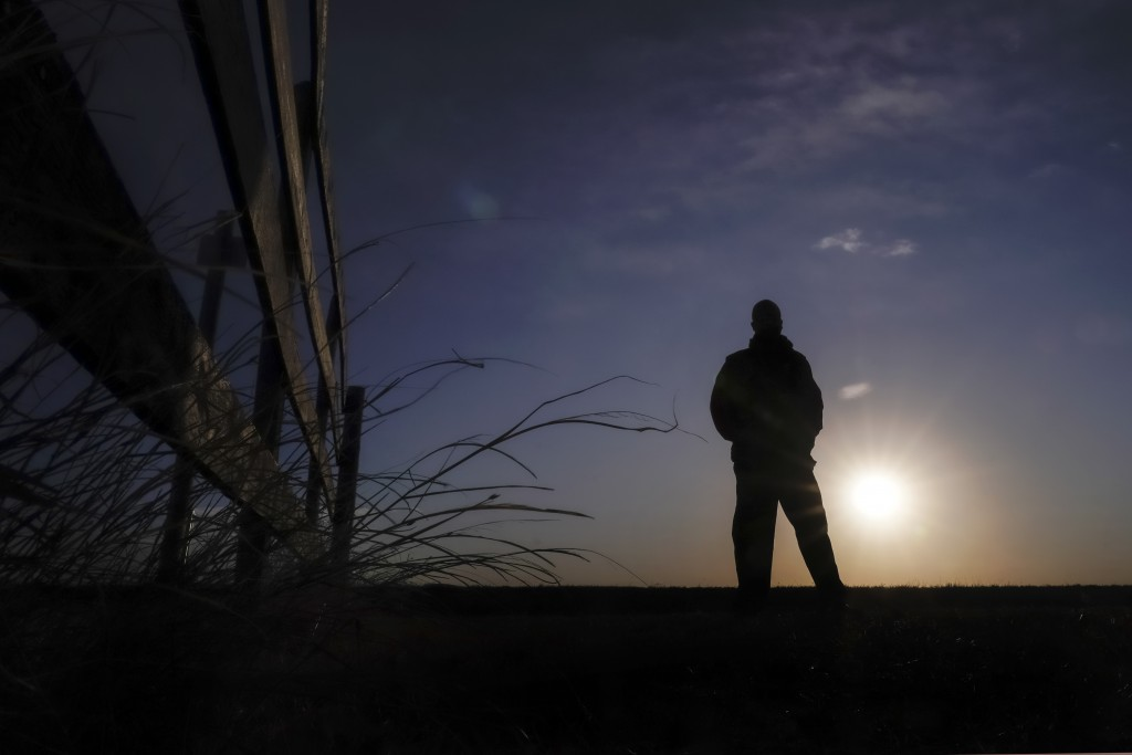Lateef Dowdell watches the sunrise from what remains of land once belonging to his uncle Gil Alexander, who was the last active Black farmer in the co...