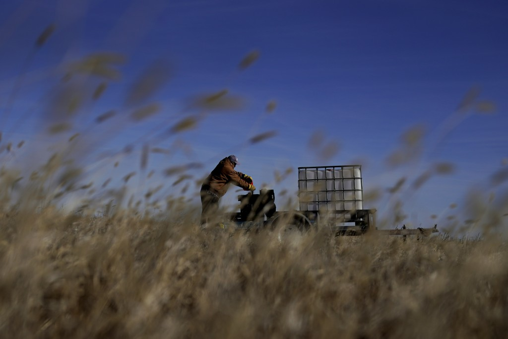 Rod Bradshaw tries to start an air compressor as he does chores on his farm near Jetmore, Kan., Wednesday, Jan. 13, 2021. Bradshaw, who claims to be t...