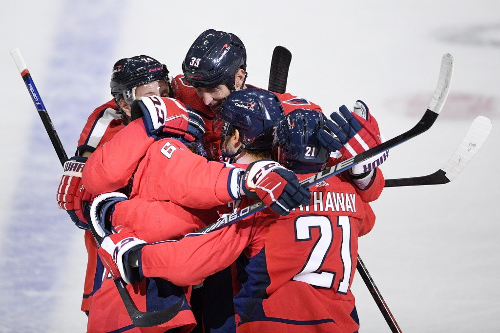 Washington Capitals defenseman Zdeno Chara (33) celebrates his goal with right wing Garnet Hathaway (21) and others during the first period of an NHL ...