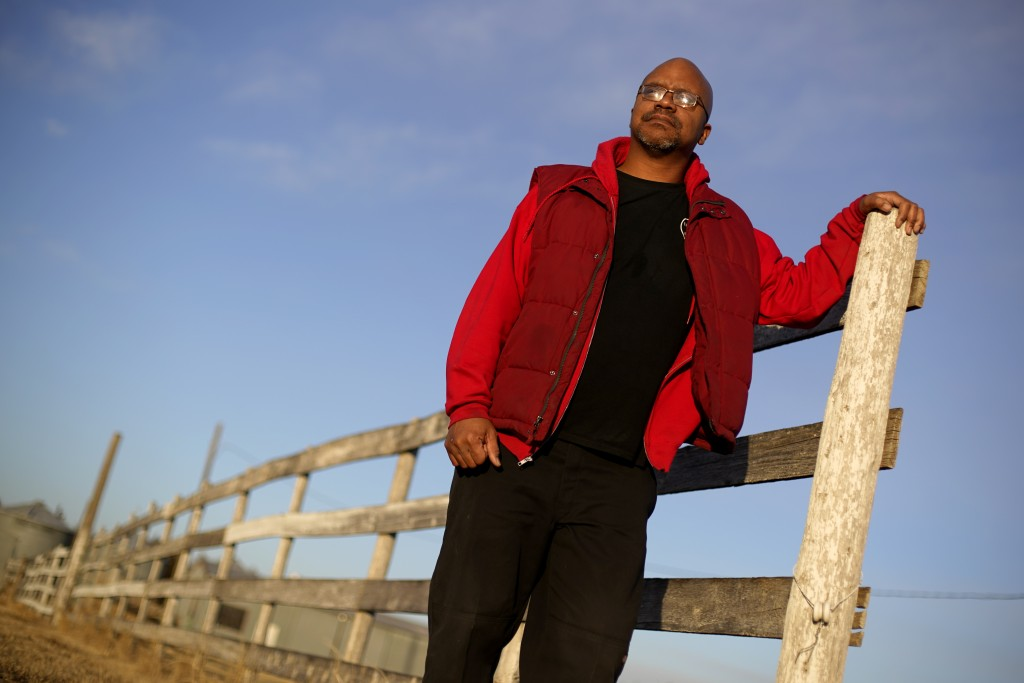 Lateef Dowdell stands on land once belonging to his uncle Gil Alexander, who was the last active Black farmer in the community of Nicodemus, Kan., Thu...