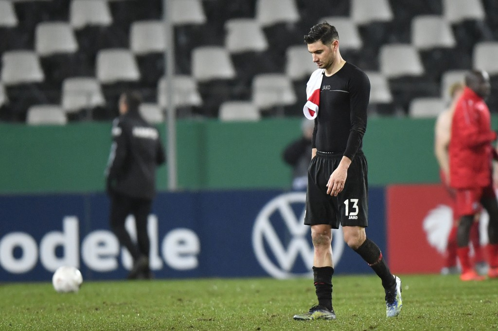 Leverkusen's Lucas Alario leaves the pitch after the German Soccer Cup 3rd round match between RW Essen and Bayer Leverkusen in Essen, Germany, Tuesda...