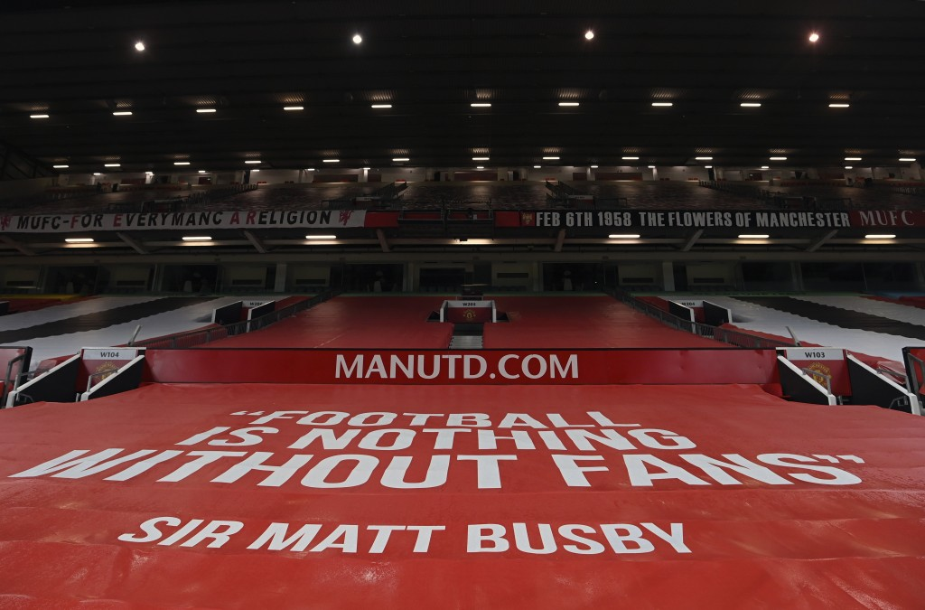 A general view of empty stands at the Old Trafford stadium before the English Premier League soccer match between Manchester United and Southampton, i...