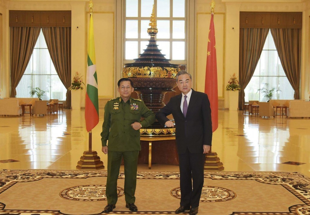 FILE - In this Jan. 12, 2021, file photo provided by Myanmar Military Information Team, Myanmar's Army Commander Senior Gen. Min Aung Hlaing, left, an...