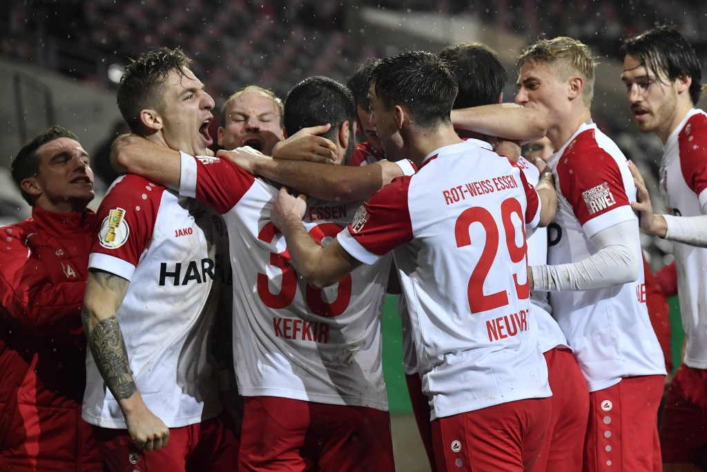 Essen's Oguzhan Kefkir, second from left, celebrates after scoring his side's first goal during the German Soccer Cup 3rd round match between RW Essen...