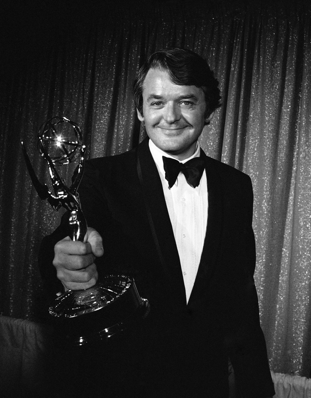 "FILE - Actor Hal Holbrook hold his Emmy Award for best actor in a drama series for his role in ""The Senator"" at the Emmy Awards in Los Angeles on May ..."