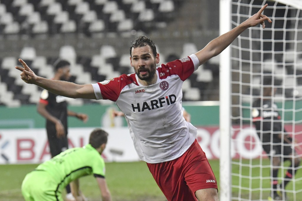 Essen's Simon Engelmann celebrates after scoring his side's second goal during the German Soccer Cup 3rd round match between RW Essen and Bayer Leverk...