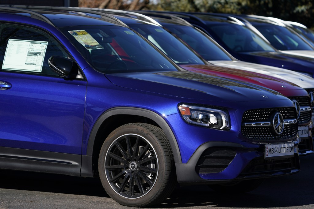 In this Nov. 15, 2020 photo, a long row of unsold 2020 GLB250 sports-utiity vehicles sits at a Mercedes Benz dealership in Littleton, Colo. The brand ...