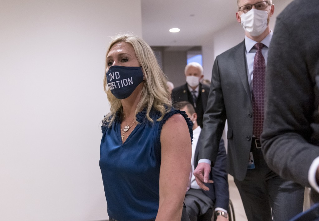 Rep. Marjorie Taylor Greene, R-Ga., walks with fellow House Republicans on Capitol Hill in Washington, Wednesday, Feb. 3, 2021, following a meeting ca...