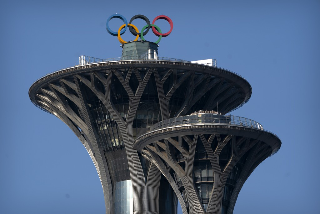 The Olympic rings are visible atop the Olympic Tower in Beijing, Tuesday, Feb. 2, 2021. The 2022 Beijing Winter Olympics will open a year from now. Mo...