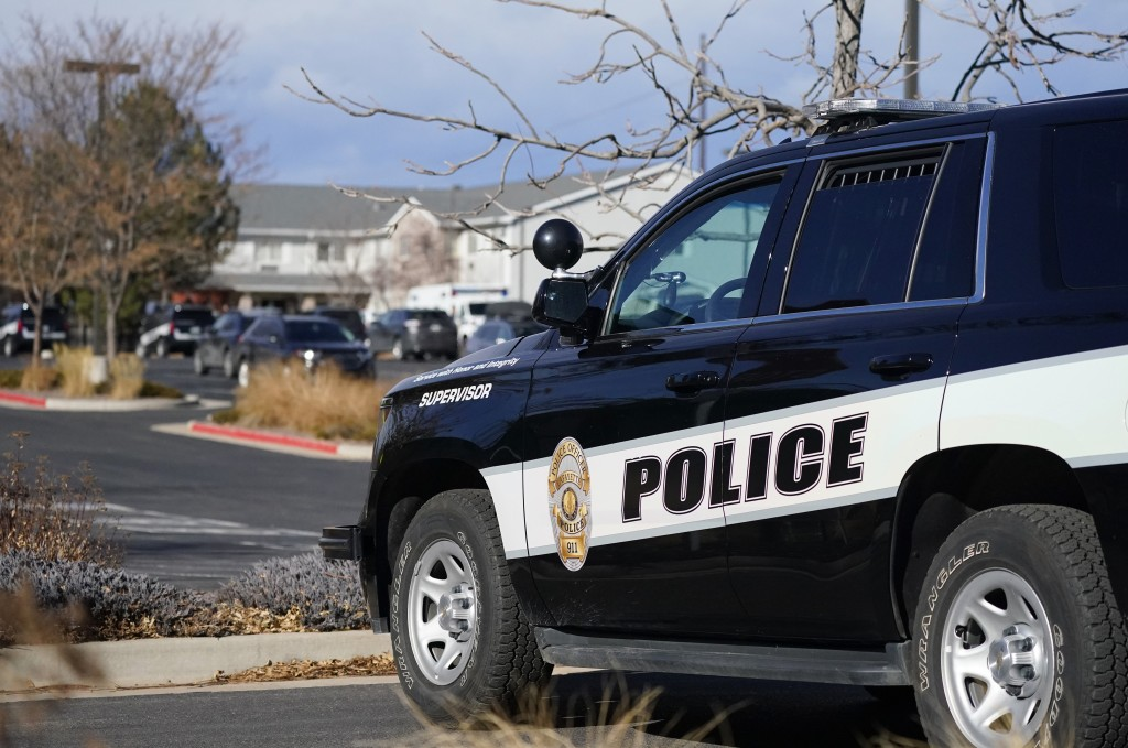 A police cruiser blocks access to the Legacy Assisted Living at Lafayette care facility, Wednesday, Feb. 3, 2021, in Lafayette, Colo. A 95-year-old re...