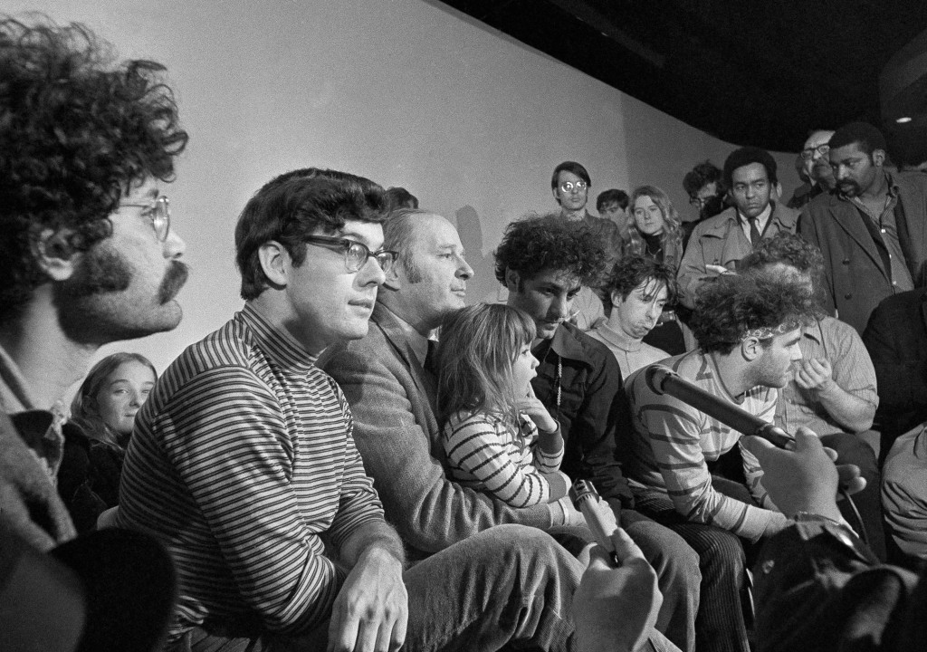FILE - In this Feb. 28, 1970, file photo, the seven defendants in the Chicago Conspiracy Trial hold a press conference in Chicago after the 7th Circui...