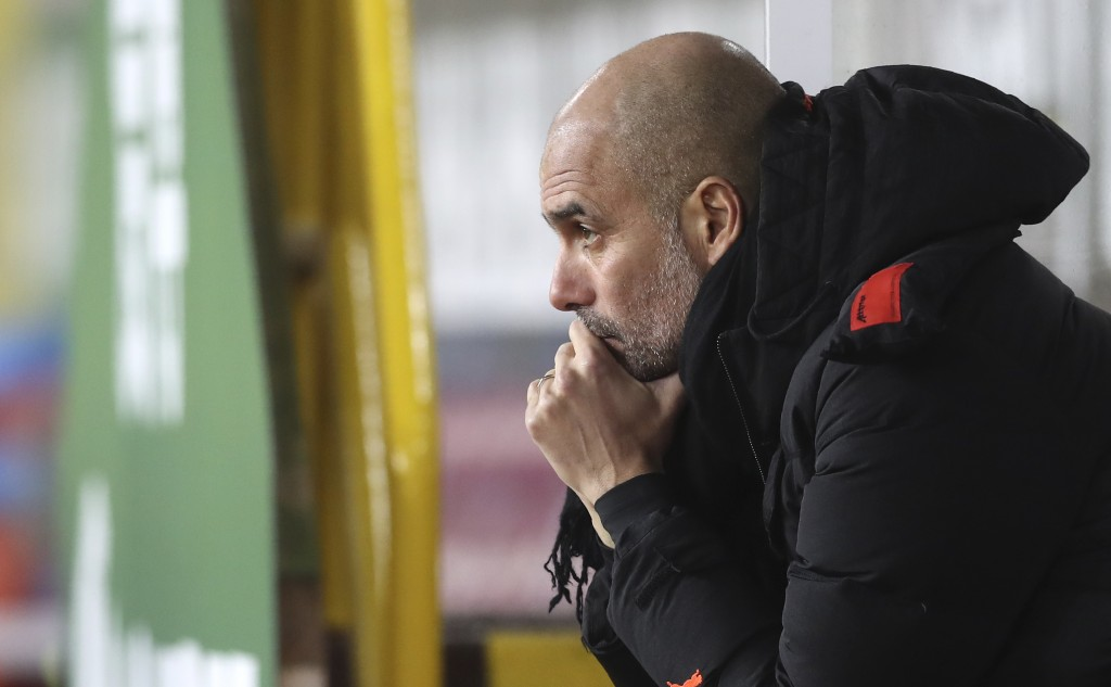 Manchester City's head coach Pep Guardiola looks on before the English Premier League soccer match between Burnley and Manchester City at Turf Moor st...