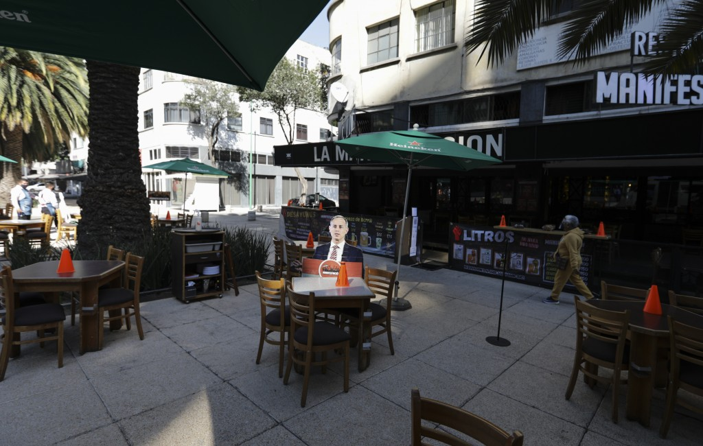 A life-size cutout of Deputy Health Secretary Hugo Lopez-Gatell is displayed on the patio of an outdoor restaurant in Mexico City, Thursday, Feb. 4, 2...