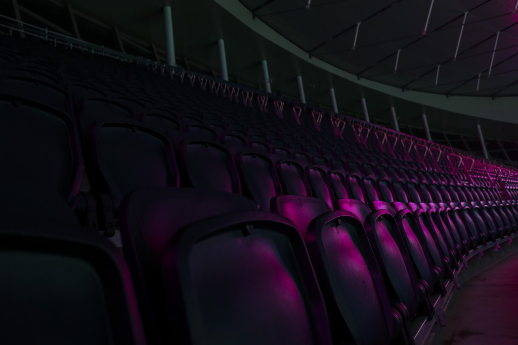 A light illuminates the empty stands before the English Premier League soccer match between Tottenham and Chelsea at the Tottenham Hotspur Stadium in ...