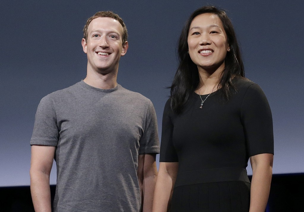 FILE - In this Sept. 20, 2016, file photo, Facebook CEO Mark Zuckerberg and his wife, Priscilla Chan, smile as they prepare for a speech in San Franci...