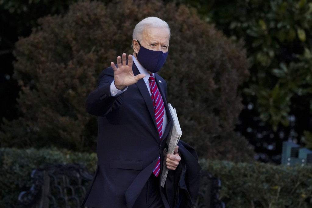 President Joe Biden waves as he walks to board Marine One on the South Lawn of the White House, Friday, Feb. 5, 2021, in Washington. (AP Photo/Alex Br...