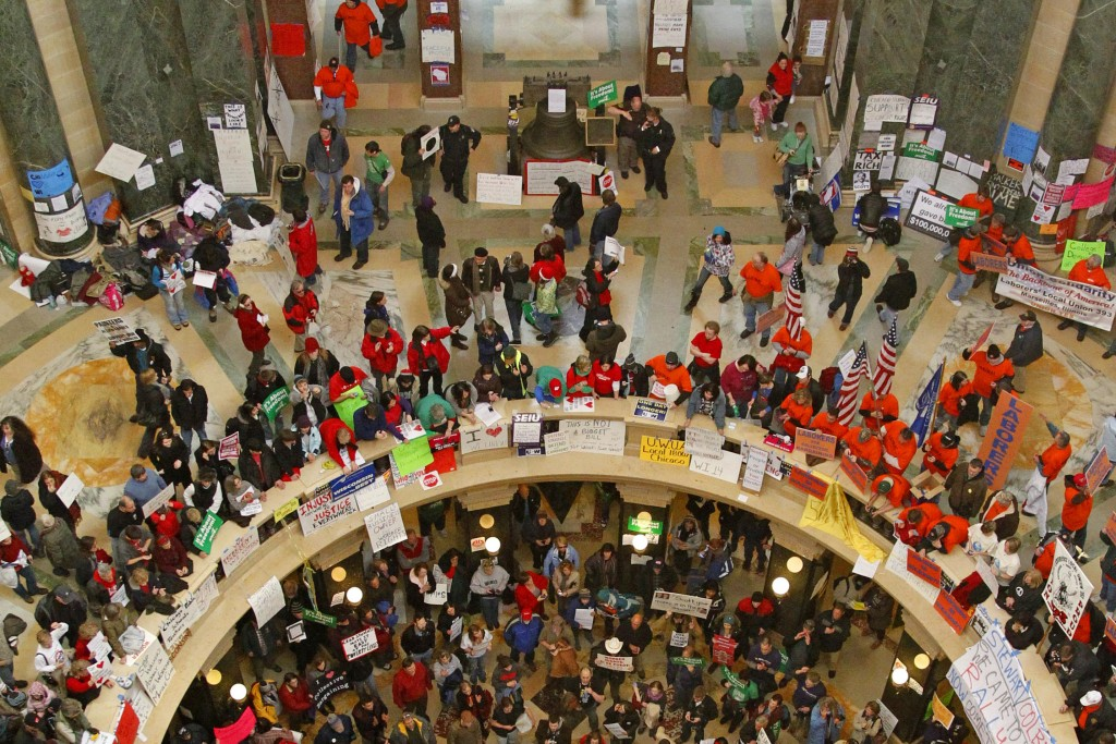 FILE - In this Tuesday, Feb. 22, 2011 file photo, pro-labor protesters bang drums and chant inside the state Capitol in Madison, Wis., during their ei...