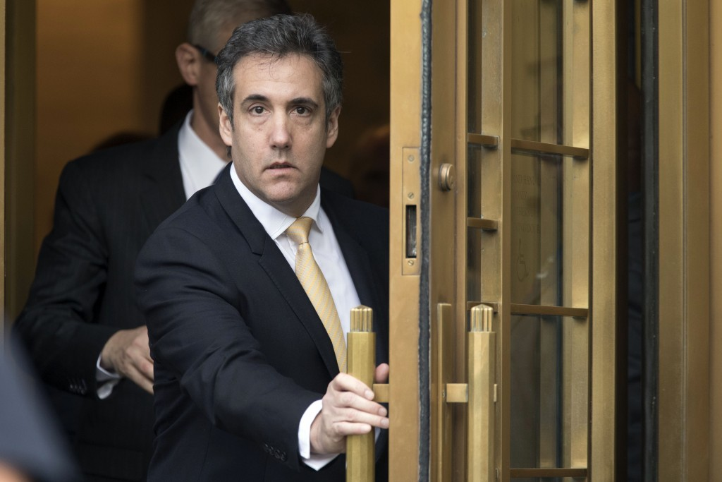 FILE - In this Aug. 21, 2018, file photo, Michael Cohen leaves federal court, in New York. More than two weeks after Donald Trump left the White House...