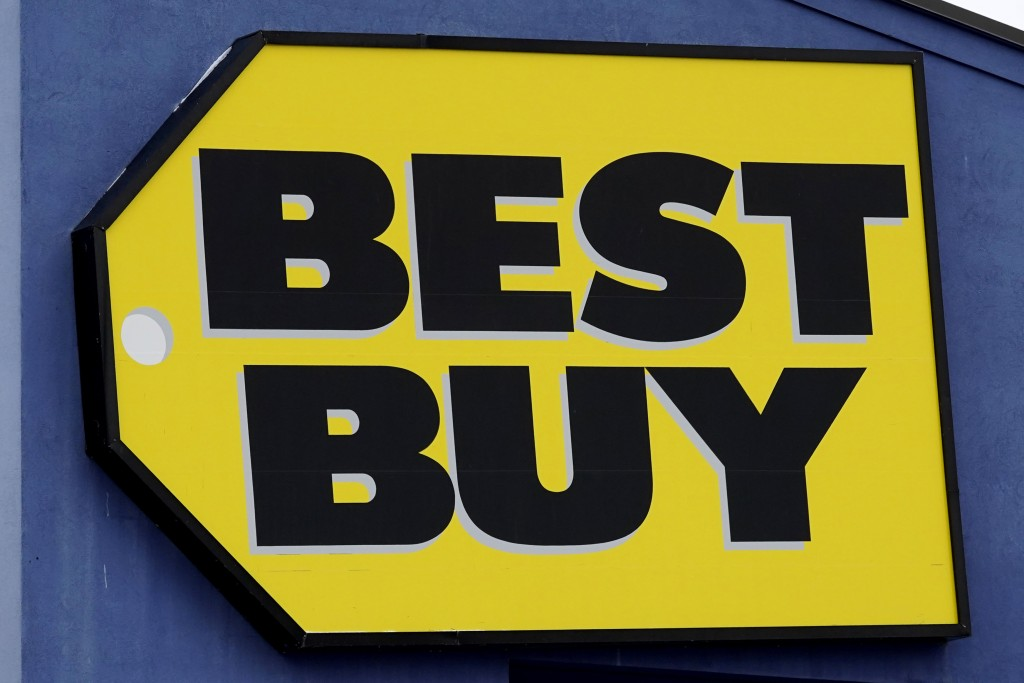 A Best Buy store sign is displayed in Arlington Heights, Ill., Saturday, Feb. 6, 2021. Best Buys is closing five stores in four states in the next mon...