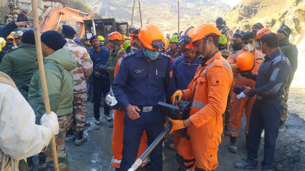 This photograph provided by National Disaster Response Force (NDRF) shows NDRF personnel search for more than three dozen power plant workers trapped ...