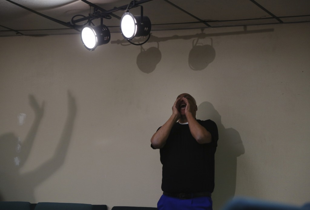 A congregant of Faith Center Church in Bluefield, W.Va., calls out in praise and worship during church services Sunday, Jan. 24, 2021. This was the mu...