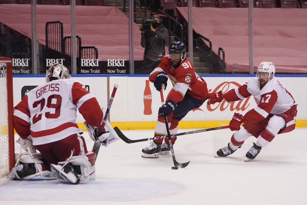 Florida Panthers left wing Anthony Duclair (91) attempts a shot against Detroit Red Wings goaltender Thomas Greiss (29) and defenseman Filip Hronek (1...
