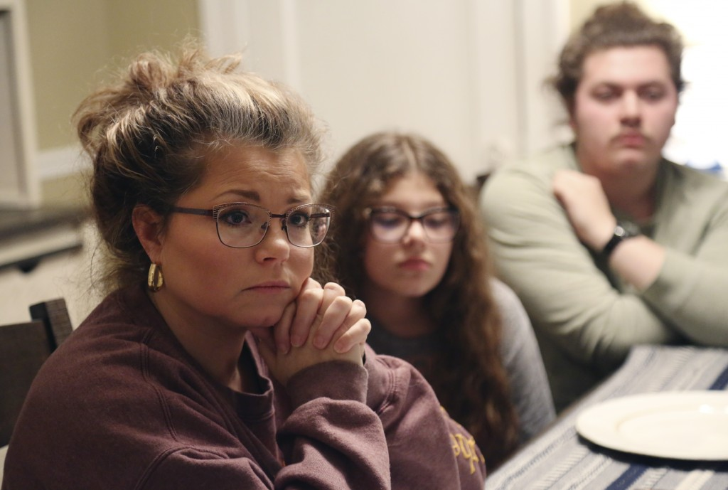 From left, Gina Brooks; her daughter Jocelyn, 13; and her son Jacob, 18, discuss their faith, values and political views, in Bluefield, W.Va., on Mond...