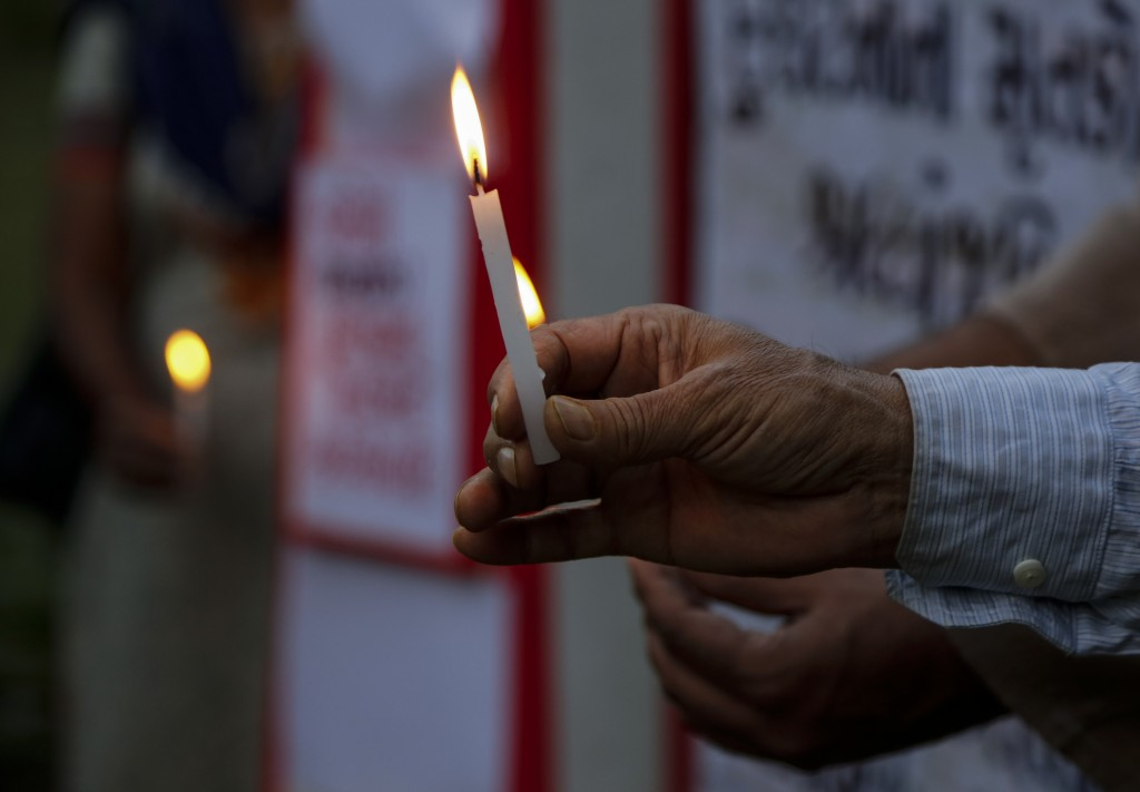 Activists of Socialist Unity Center of India (SUCI) light candles in Ahmedabad, India, for the victims of glacier flooding in the northern state of Ut...