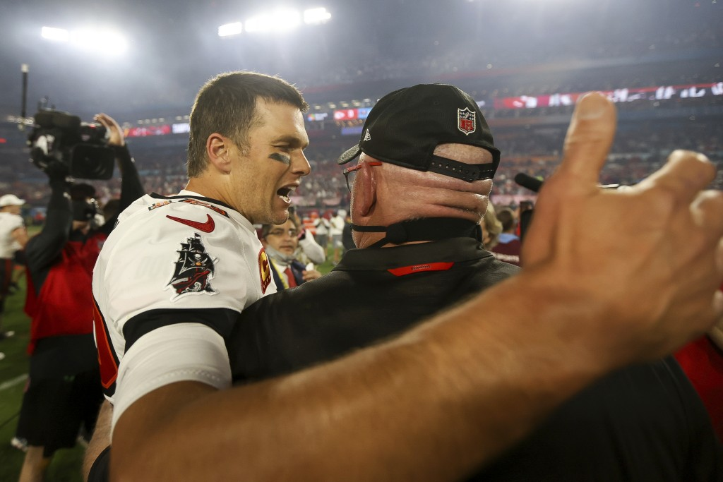 Tampa Bay Buccaneers quarterback Tom Brady (12) celebrates with head coach Bruce Arians following the NFL Super Bowl 55 football game against the Kans...