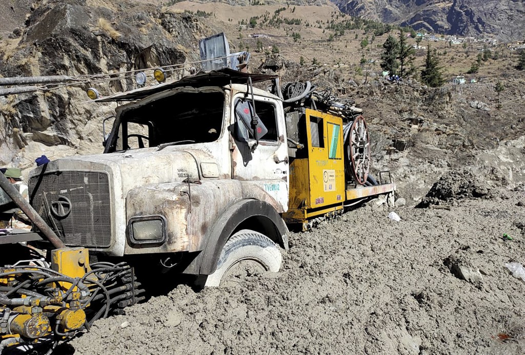 A hydro project vehicle is seen stuck in slash and mud at Reni village in the Tapovan area of ​​Chamoli district, in Indian state of Uttrakhund, Monda...