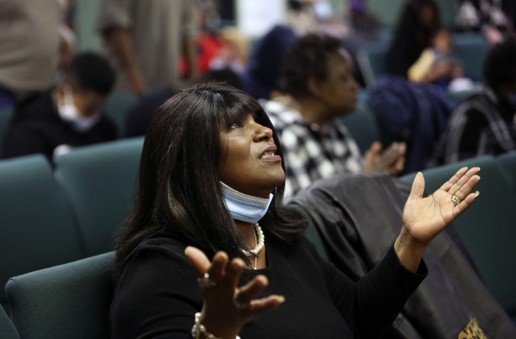 A congregant of the Faith Center Church lifts her hands toward the sky as she worships with others in Bluefield, W.Va., on Saturday, Jan. 24, 2021. (A...