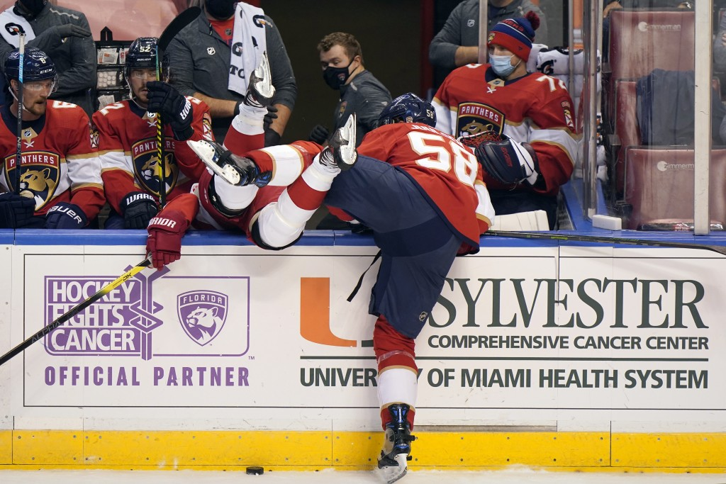 Florida Panthers defenseman Noah Juulsen (58) sends Detroit Red Wings right wing Bobby Ryan over the wall during the first period of an NHL hockey gam...