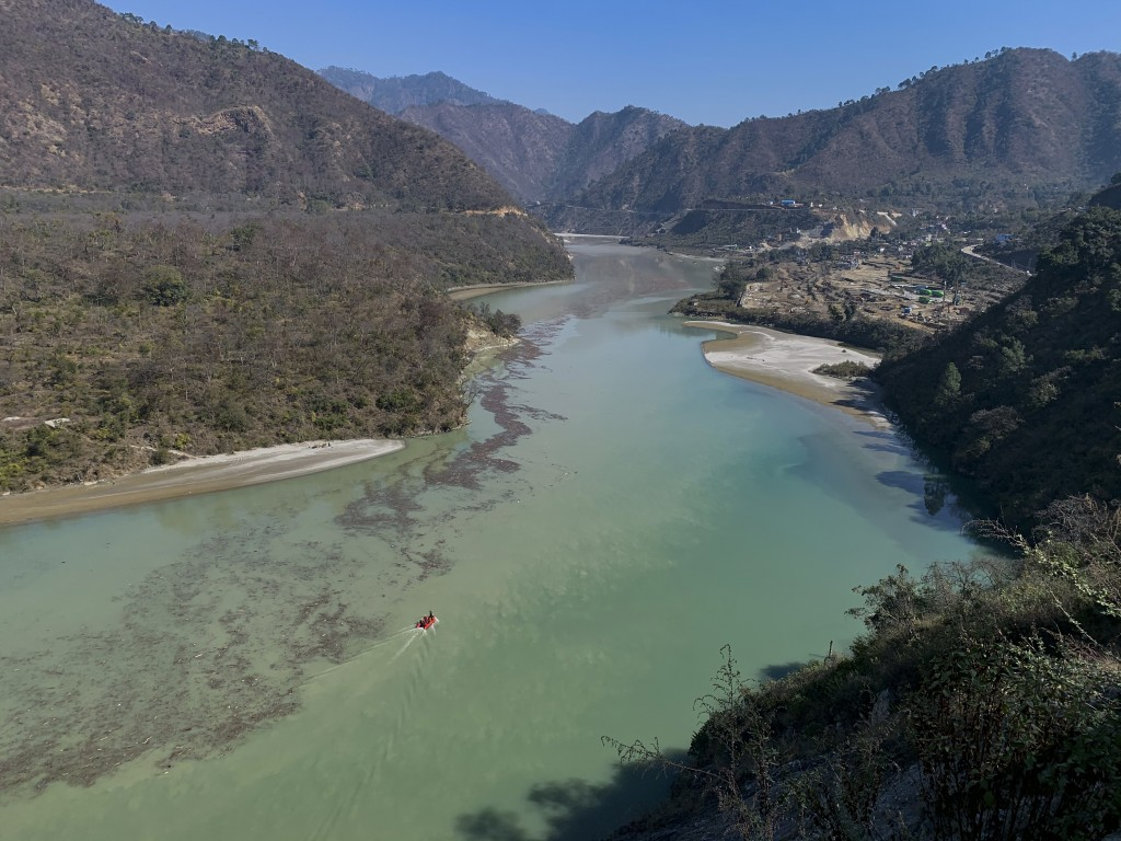 Rescuers leave on a boat to search for bodies in the downstream of Alaknanda River in Rudraprayag, northern state of Uttarakhand, India, Monday, Feb.8...