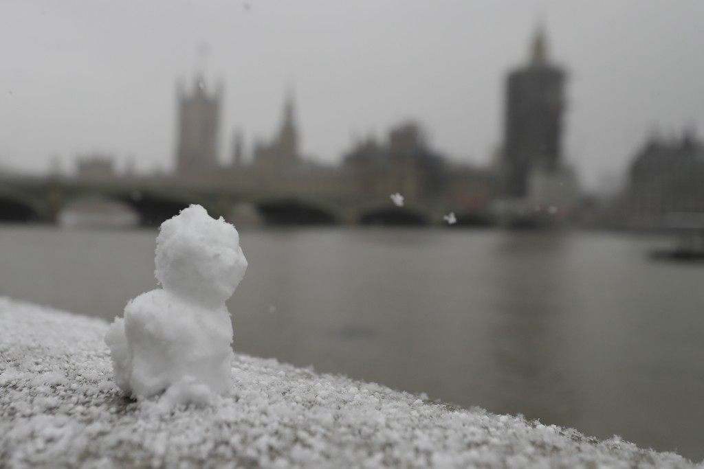 A little snowman sits on the embankment opposite parliament as temperatures dropped below freezing during the third coronavirus lockdown in London, Tu...