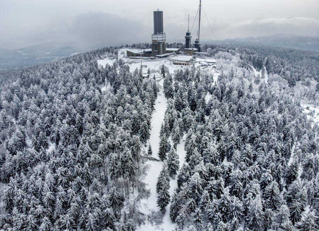 Trees are covered with ice rain, frozen fog and snow on top of the Feldberg mountain near Frankfurt, Germany, Tuesday, Feb. 9, 2021. Temperatures on t...