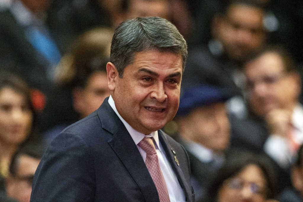 FILE - In this Jan. 14, 2020, file photo, Honduras' President Juan Orlando Hernandez arrives for the swearing-in ceremony for Guatemala's new Presiden...