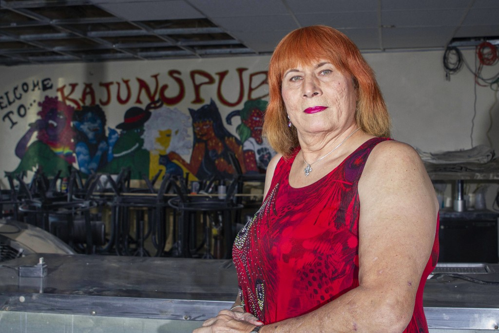 Joann Guidos, who opened Kajun's Pub on St. Claude in 2004, poses for a portrait in New Orleans, Friday, Jan. 29, 2021. Guidos closed for a few months...