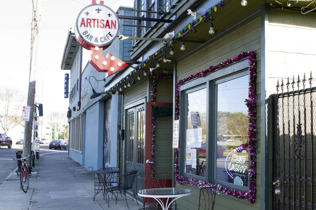 A bike sits outside Artisan Bar and Cafe on St. Claude Avenue on Jan. 30, 2021, in New Orleans. The toll of this year's toned-down Mardi Gras is evide...