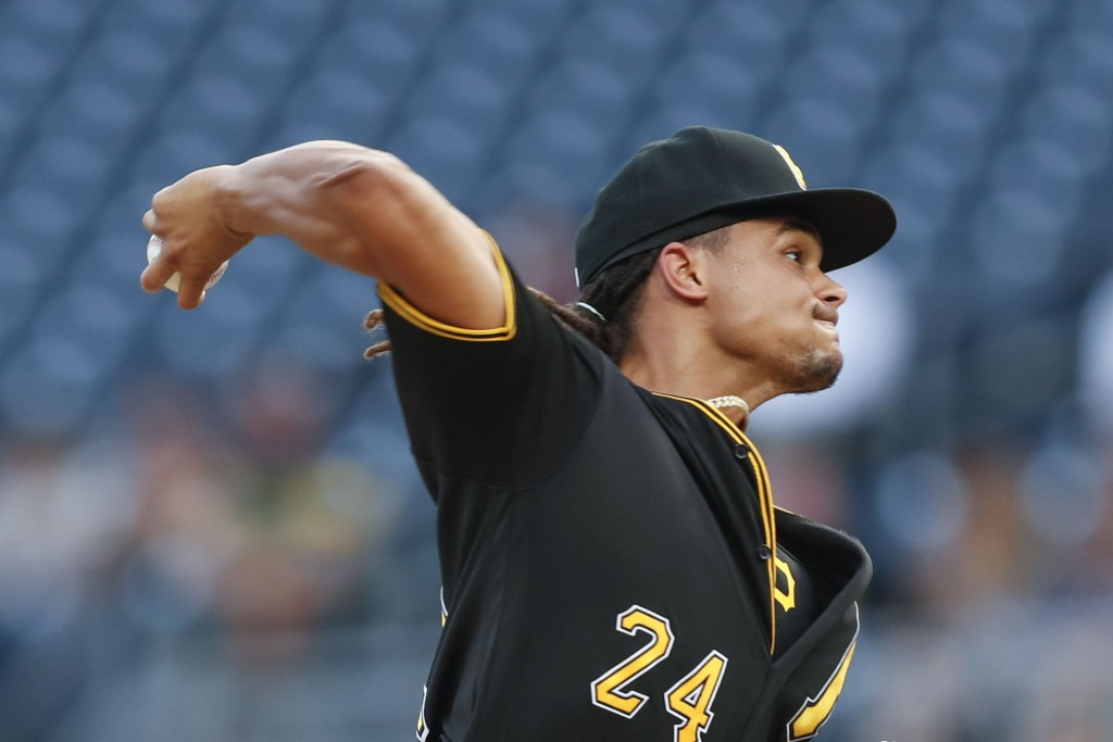 FILE - In this Tuesday, Aug. 20, 2019, file photo, Pittsburgh Pirates starter Chris Archer pitches against the Washington Nationals in the first innin...