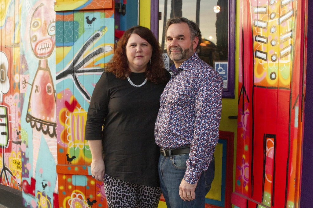 Jennifer and Matt Johnson pose for a portrait in New Orleans, Friday, Jan. 29, 2021. They bought what is now the Carnaval Lounge on St. Claude in summ...