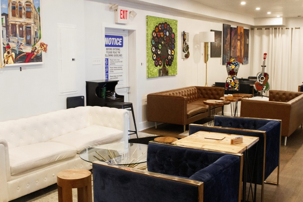 An indoor seating area is vacant at the NOLA Art Bar in New Orleans, Saturday, Jan. 30, 2021. DJ Johnson's business — NOLA Art Bar — opened just six w...