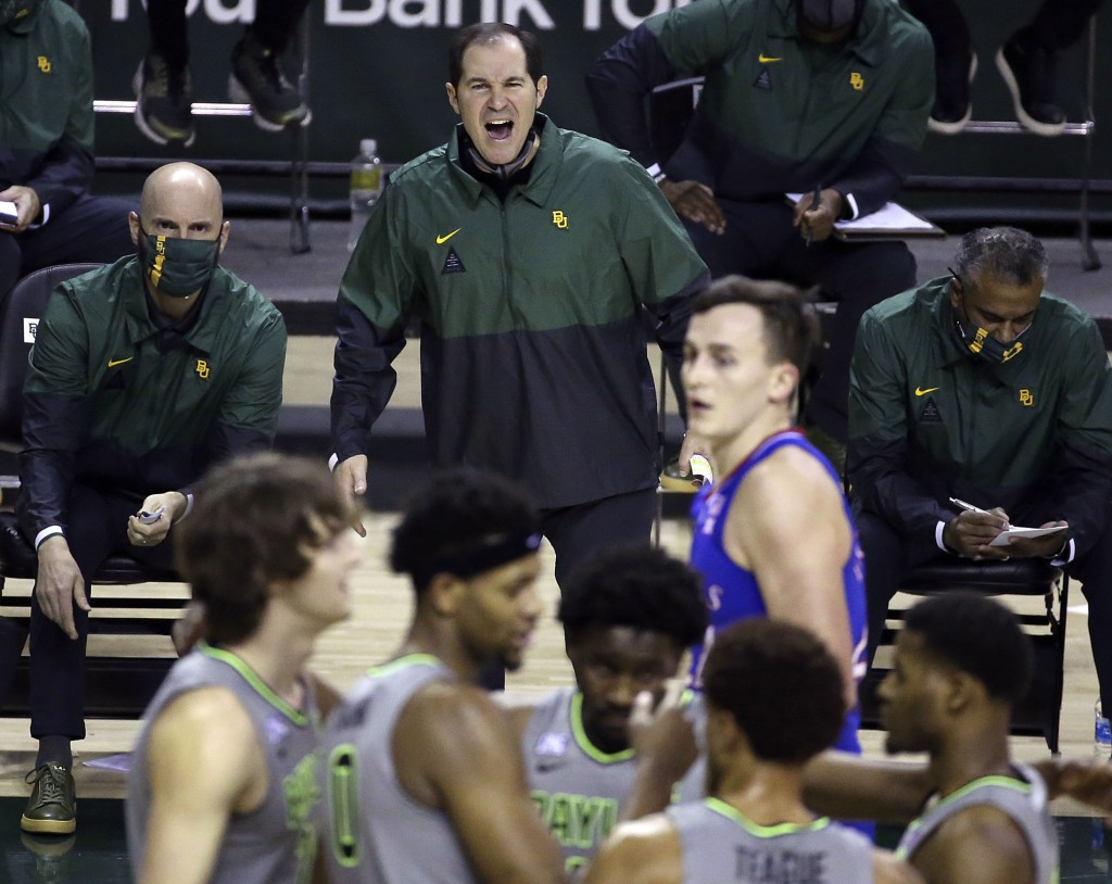 File-Baylor head coach Scott Drew, top center, reacts to a play in the second half of an NCAA college basketball game against Kansas, Monday, Jan. 18,...
