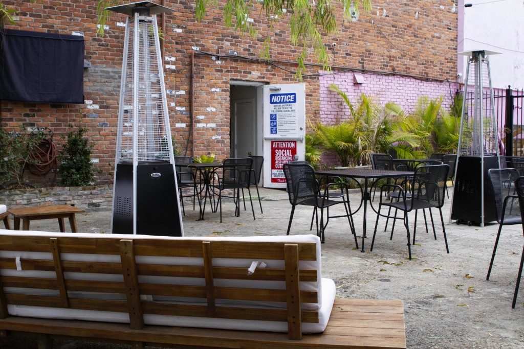 An outdoor seating area is seen at the NOLA Art Bar in New Orleans, Saturday, Jan. 30, 2021.  DJ Johnson's business — NOLA Art Bar — opened just six w...
