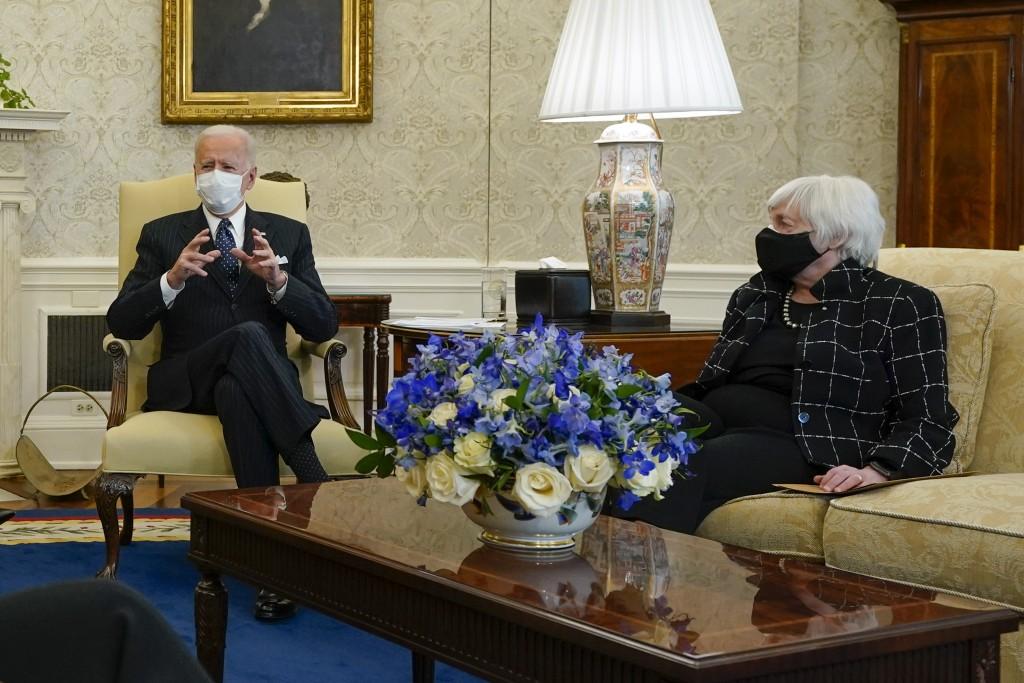 President Joe Biden, accompanied by Vice President Kamala Harris and Treasury Secretary Janet Yellen, meets with business leaders to discuss a coronav...