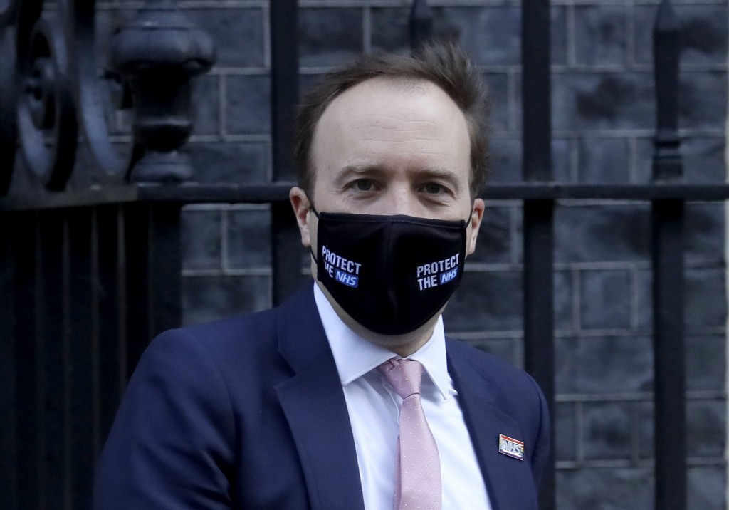 Britain's Secretary of State for Health Matt Hancock leaves 10 Downing Street in London, Wednesday, Feb. 10, 2021. (AP Photo/Kirsty Wigglesworth)