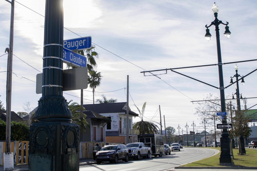 A street sign hangs on St. Claude Avenue, Jan. 30, 2021, in New Orleans. The toll of this year's toned-down Mardi Gras is evident on St. Claude Avenue...