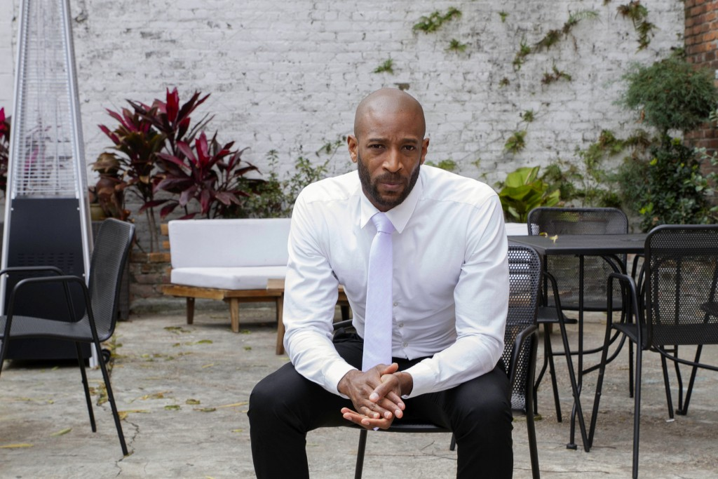 DJ Johnson poses for a portrait in New Orleans, Saturday, Jan. 30, 2021. Johnson's business — NOLA Art Bar — opened just six weeks before the pandemic...