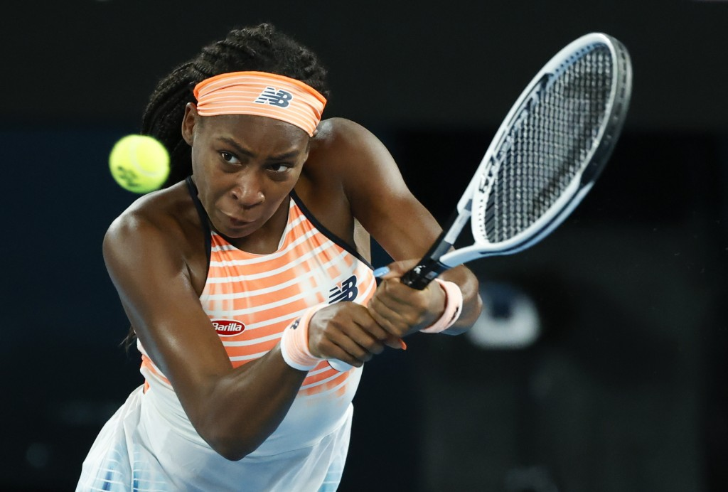 United States' Coco Gauff makes a backhand return to Ukraine's Elina Svitolina during their second round match at the Australian Open tennis champions...